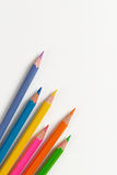 Colourful wooden pencils on a white sheet Stock Photography