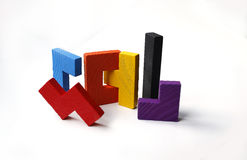 Colourful wooden puzzle blocks on white background Stock Image