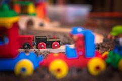 Wooden toy train on a room floor. Colourful wooden toy train on the carpet in the living room in the house stock photo