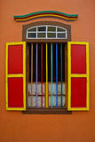 Colourful wooden window with grills. Of Residence of Tan Teng Niah in Little India, Singapore. The leaf windows are opened with no curtain but only safety Stock Image