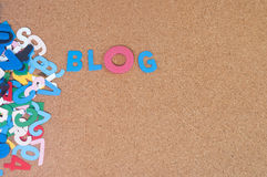 Colourful word blog with cork board as background Royalty Free Stock Images