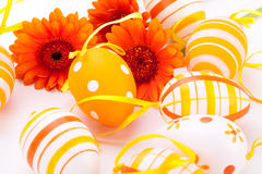 Colourful yellow decorated Easter eggs. Colourful yellow hand decorated traditional Easter eggs with stripes and polka dot patterns arranged with colourful Stock Photography