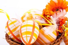 Colourful yellow decorated Easter eggs. Colourful yellow hand decorated traditional Easter eggs with stripes and polka dot patterns arranged with colourful Royalty Free Stock Image