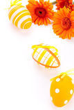Colourful yellow decorated Easter eggs. Colourful yellow hand decorated traditional Easter eggs with stripes and polka dot patterns arranged with colourful Royalty Free Stock Photos