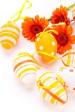 Colourful yellow decorated Easter eggs. Colourful yellow hand decorated traditional Easter eggs with stripes and polka dot patterns arranged with colourful Royalty Free Stock Photo