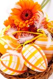 Colourful yellow decorated Easter eggs. Colourful yellow hand decorated traditional Easter eggs with stripes and polka dot patterns arranged with colourful Stock Image