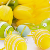 Colourful yellow and green spring Easter Eggs Stock Images