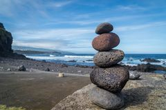Colourful yoga stones at the beach at azores stock photography