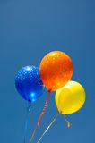 Colourfull balloons against blue sky. Stock Photos