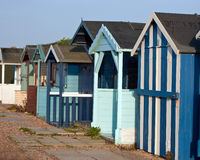 Colourfull beach huts. A row of worn but colourfull beach huts Royalty Free Stock Photography