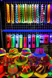 Colourfull and bright hats and beads for nightparty Stock Images