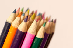 Colourfull Crayons Coloured Pencils. Pink, green, orange purple blue yellow Stock Images