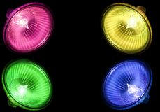 Colourfull halogen spots. Four different coloured halogen spots on a black background Stock Photography