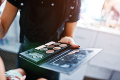 Colourfull make up palette on hand of makeup master on work at royalty free stock photos