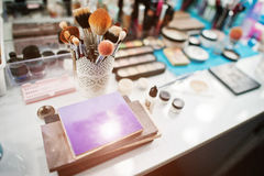 Colourfull make up palette and set of brushes for makeup at  bea Royalty Free Stock Images