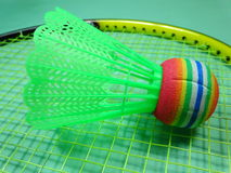 Colourfull plastic shuttlecock on badminton racket Royalty Free Stock Photos