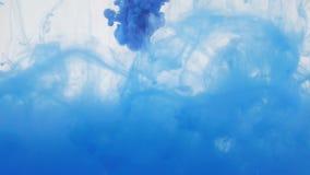 Colourfull tła abstrakcja niebieskiego atramentu wody zbiory