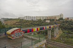 Colourfull train track through urban wasteland with apartment blocks Stock Images