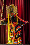 A colourfully costumed Mask Dancer performs at the Esala Perahara theatre show in Kandy, Sri Lanka. The Esala Perahera runs every year in late July or early Stock Photo