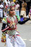 A colourfully dressed dancer performs during the Hikkaduwa Perahera in Sri Lanka. A colourfully dressed dancer performs through the streets during the Hikkaduwa Royalty Free Stock Photography