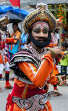 A colourfully dressed dancer performs through the streets during the Hikkaduwa Perahera. 