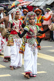 Colourfully dressed dancers perform during the Hikkaduwa Perahara on the west coast of Sri Lanka. The perahera is held to honour the sacred tooth relic of Lord Stock Photography