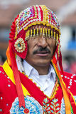A colourfully dressed man poses for a phototgraph in a Cusco street during the May Day parade in  Peru. A colourfully dressed man poses for a phototgraph at Royalty Free Stock Image
