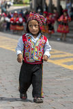 A colourfully dressed performer dances down a Cusco street during the May Day parade in  Peru. A colourfully dressed Peruvian boy performs at Plaza de Armas in Stock Photo