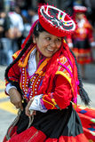 A colourfully dressed performer dances down a Cusco street during the May Day parade in  Peru. A colourfully dressed Peruvian lady performs at Plaza de Armas in Royalty Free Stock Photos