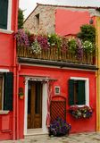 Colourfully painted house in Burano, Italy. Small brightly painted house decorated with flowers in Burano in northern Italy Royalty Free Stock Photo