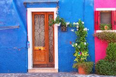 Colourfully painted house facade on Burano. Island, Italy Royalty Free Stock Images