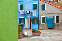 Colourfully painted house facade on Burano island. Province of Venice, Italy Stock Photo