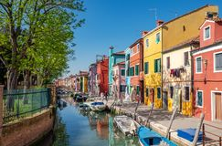 Colourfully painted houses in island Burano, Italy royalty free stock photography