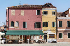 Colourfully painted houses on Burano island,Italy. BURANO,ITALY - 25.06.15 :  Colored houses in Burano -an island in the Venetian Lagoon .Is known for its small Royalty Free Stock Images