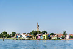 Colourfully painted houses on Burano island,Italy and  the Tower of the Church of San Martino Stock Photos