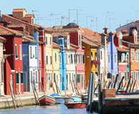 Colourfully painted houses on Burano island near Venice in north. Colourfully painted houses on Canal in Burano island near Venice in northen Italy Stock Photos