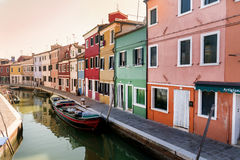 Colourfully painted houses and canal with boats on Burano island,Italy Stock Image