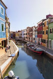 Colourfully painted houses and canal with boats on Burano island,Italy Stock Photo