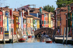 Colourfully painted houses on Canal in Burano island near Venice. Colourfully painted houses and a bridge on Canal in Burano island near Venice in northen Italy Royalty Free Stock Photography