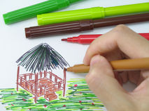 Colouring. With ink pens (with drawing and pens in focus royalty free stock image