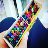 Colouring anyone?. A box full of rainbow crayons ready to colour some art project stock images