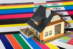 Colouring of the  house by a paint. Stock Image