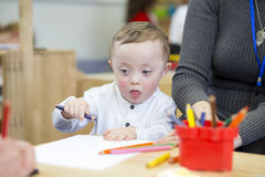 Colouring in at nursery Stock Photos