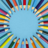 Colouring pencil border - blue. Colouring pencils on a blue background Royalty Free Stock Photo