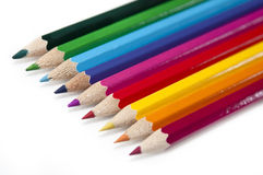 Colouring Pencils. A row of brightly coloured pencils Stock Image