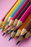 Colouring Pencils. Close-up image of colourful colouring pencils against a pink background Stock Photo