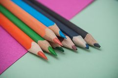 Colouring pencils on color background royalty free stock photo