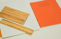 Colouring pencils and note books Stock Images
