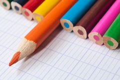 Colouring pencils on notebook background Stock Images