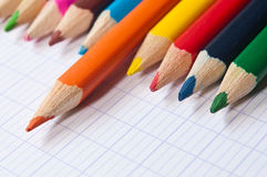 Colouring pencils on notebook background Stock Photos